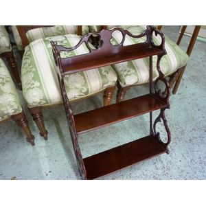 An interesting 1920's-30's mahogany ornate wall shelf with features of scrolls, cut out and shaped in good polished condition....