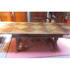 French-Spannish influenced Oak parquetry dining table with wrought iron base stretcher joining carved legs.