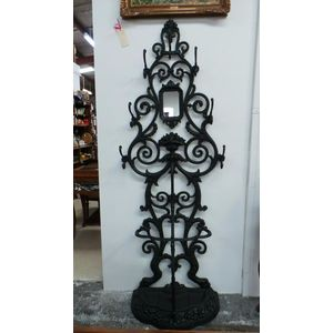 Black Antique cast iron coat/hat stand, with eight hooks and a section to store all your umbrellas in fantastic condition.