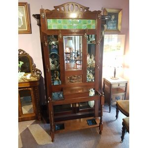 Walnut art nouveau hallstand ,glovebox original hooks bevilled mirror tiles copper panel with sailing ship . In great condition...