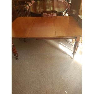 Lovely antique  mahogany one leaf extension dining table  .A mellow golden colour reeded legs on castors in great condition ....