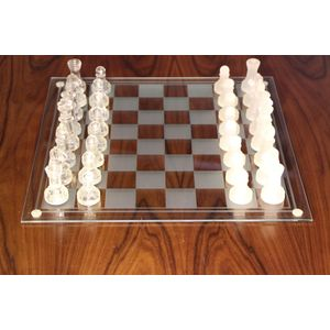 Unusual Art Deco style chess set with frosted glass and etched crystal chess board with bevel edge and supported on four...