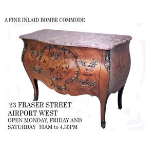 An excellent inlaid kingwood marble top bombe commode. In lovely original condition, retaining original decorative handles and...