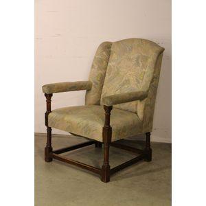 A rare English oak upholstered