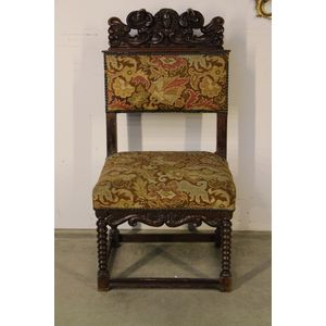 A very rare walnut Renaissance period side chair or wainscot chair. The ornate carved walnut maskhead top  with scrollwork...