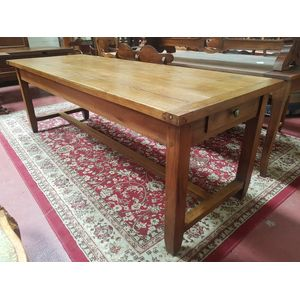 French oak farmhouse dining table with drawers at both ends. Solid oak tapered legs with stretcher base. Seats 8 to 10.