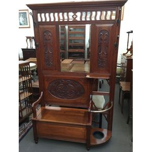 Great quality C.F. Rojo Solid Blackwood Hallstand with Art Nouveau carved panels, stylised brass hooks, flip top trunk, drip...