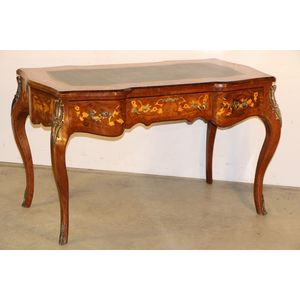 A very impressive Marquetry inlaid writing desk in the French Louis XV manner. Superbly inlaid in fruitwoods with ornate design...