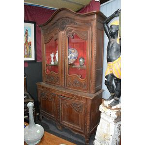 A delightful and totally original French 18th C Fruitwood four door cabinet with carved urn,floral and foliate decoration....