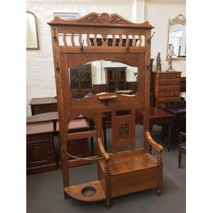 Solid English Oak Hallstand with carved panels, shaped and bevilled mirror, flip top seat box, drip tray, original hooks and...