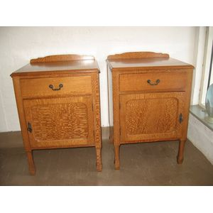 Pair silky oak bedside cabinets. Both in excellent condition with striking grain. Each has original key for locking.