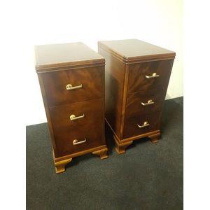 Pair walnut Art Deco bedside cabinets. Matching pair of 3 drawers with chrome bakellite handles.