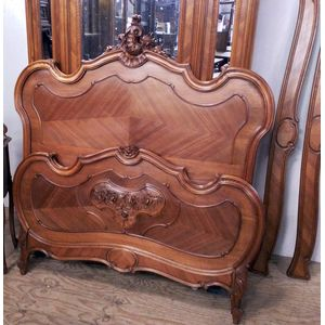 A fine quality walnut double bed in the Louis XV manner. Beautiful shape and excellent detailed carving. In lovely original...