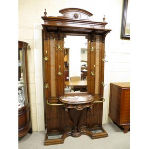 A fine French oak hallstand dating to the turn of the last century, retaining all original fitments. Features include an...
