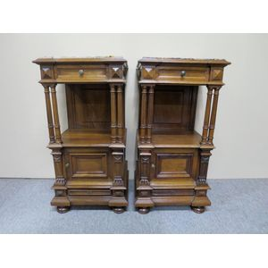 An excellent pair of large French walnut bedside cabinets in the Henri II style, each fitted with a drawer above an open...