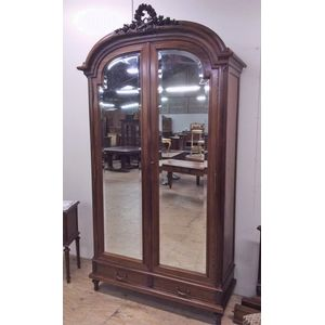 An excellent walnut two door armoire in Louis XVI style. Solid walnut with two bevelled glased doors. Detailed and beautifully...