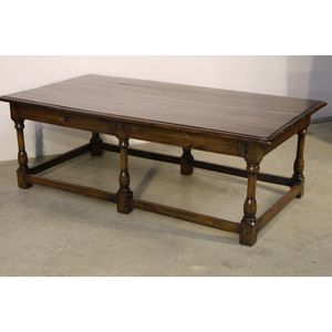 A well made refectory table in the early Georgian manner. The solid oak top raised on six turned legs joined by stretchers and...
