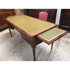 An amazing and practical Antique French Empire style tooled leather desk. Has plenty of storage space with 4 drawers and hidden...