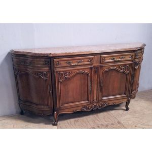 This is a substantial and beautiful walnut sideboard. Serpentine shaped ends with an inserted marble top. Four doors and...