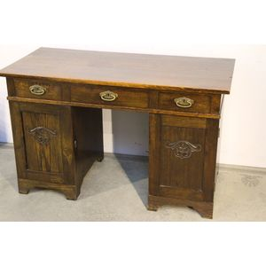 A Scandinavian Art Deco writing table or desk . This sturdy desk with beautifully solid oak pedestals and three oak drawers...