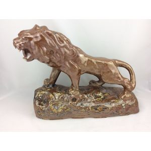 An Antique hand made glazed stoneware lion, this would be a workmen's piece and is from circa 1880. Is in good original...