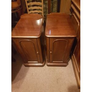 Pair of victorian ,left and right hand mahogany bedside cabinets . Arched panelled doors ,central shelve in great condition ....