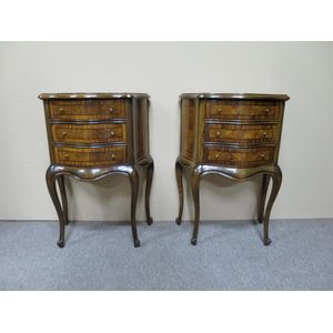 Pair of walnut bedside cabinets in the Louis XV style, each with three drawers that feature shaped serpentine fronts and...