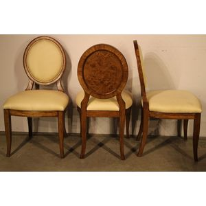 A set of four Art Deco /Biedermeier style dining chairs in blonde burr elm. The well upolstered seats with extra luxurious...