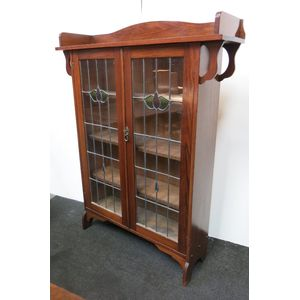 Arts and crafts- Art Nouveau blackwood bookcase with decorative leadlight doors and adjustable shelving.