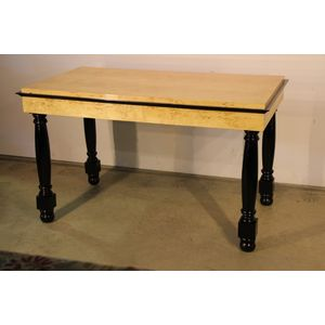 Blonde biedermeier style small dining table for 2 , 4 or 6 people raised on turned gun barrel legs with ebonised details.