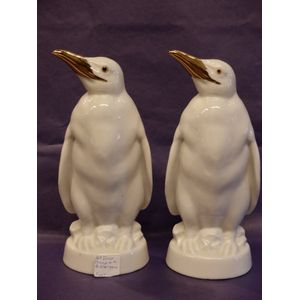 This wonderful pair of Art Deco' white porcelain penguins with gilded beaks and bright, intelligent eyes stands 