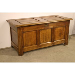 A good solid oak English coffer  or blanket box with two panel solid oak top with pegged joints in the Georgian manner. A...