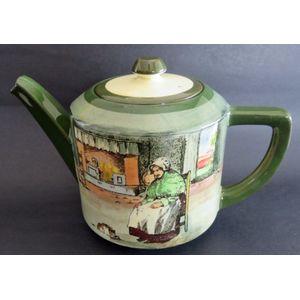 A Royal Doulton teapot in the