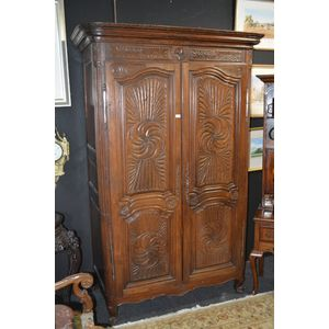 This most desirable 18th C French Provincial Fruitwood Armoire, Fitted with two full length doors,with extensive carved...
