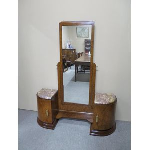 French Art Deco cheval mirror in burr walnut with an adjustable tilt and fitted with storage space. Retains original brass...