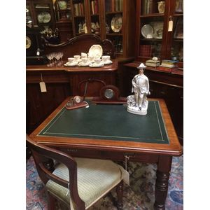 Antique writing table/desk circa 1890. Featuring green tooled leather top, 2 large drawers. Turned and fluted legs,good...