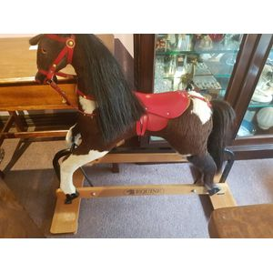 Equine rocking horse on timber