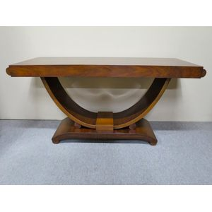 French Art Deco rosewood console table on a hoop base featuring a figured top and base. Circa 1920. In excellent restored...