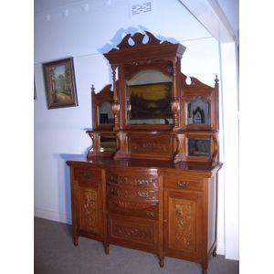 Edwardian mirror back sideboard, with ornate carvingto three doors and two drawers also to mirror back. Fully restored.