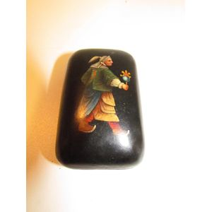 papier mache east european/german snuff box in black lacquer with hand painted man in costume.
