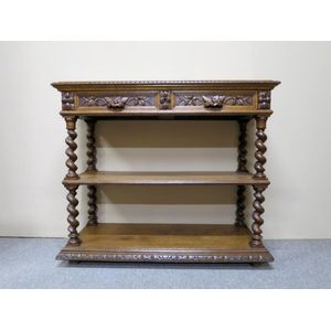 19th century French oak open-shelf servery fitted with a pair of frieze drawers, carved with foliage. Circa 1880.