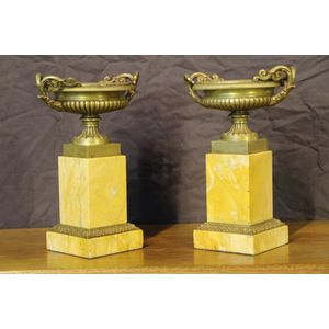 French Empire pair of superb quality antique gilt bronze ormolu urns in the neoclassical manner. These Empire vases or tazza in...