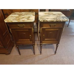 Pair of french marble top bedside cabinets . Left and right hand ,drawer and door ormulu mounts lovely marble colour . In great...