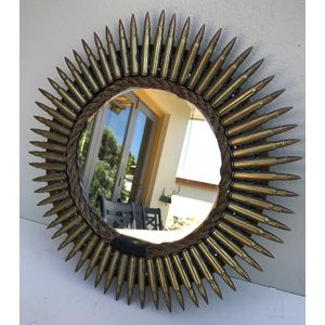 I kid you not.....a 1950's sunburst mirror made up of real bullets (de-activated!)mounted on a solid timber backing with...