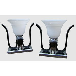 Stylish pair of 1930's French deco chrome and black lamps with moulded white glass bell shades. Lamp bases are solid chromed...