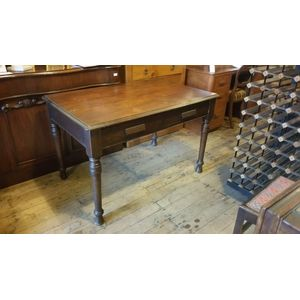An antique desk with two drawe
