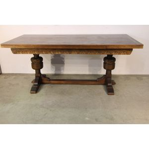 A solid carved English oak dra
