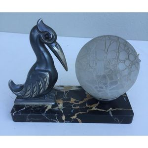 French 1930's deco stylised/cubist patinated pelican lamp on beautiful portoro marble base. Comes with its original frosted...