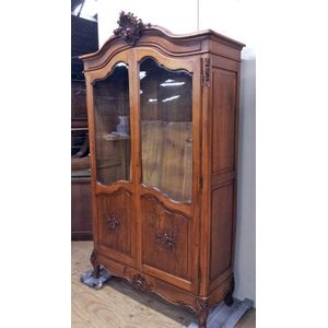 A walnut french Louis xv display cabinet/bookcase in lovely original condition. Two doors beautifully shaped, glazed with...