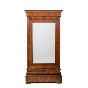 A 19th century French Charles X flame mahogany antique armoire. The single glazed door housing a cupboard fitted out for...